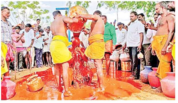 ABHISHEKAM WITH 75 KG CHILLS POWDER MIXED IN WATER