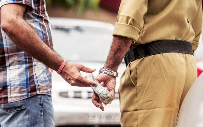Corrupted Poilce Caught taking Bribe