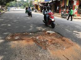 Common Man Reacted Against Worst Roads In Bangalore