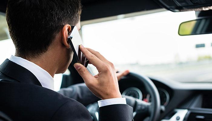 Speaking phone while driving can land you in jail